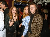 LONDON, ENGLAND - SEPTEMBER 21: (L to R) Cara Delevingne, Clara Paget and Harry Styles attend the Love Magazine miu miu London Fashion Week party at Loulou's on September 21, 2015 in London, England. Pic Credit: Dave Benett